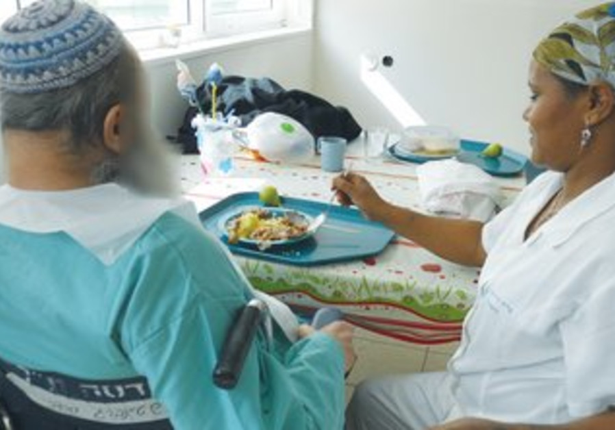 Feeding geriatric patients at Herzog Hospital.