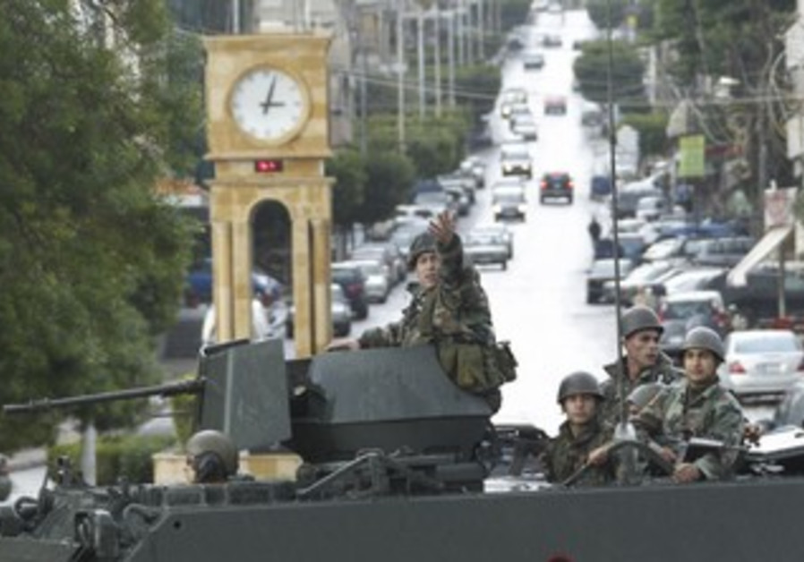 Lebanese soldiers on their military vehicle