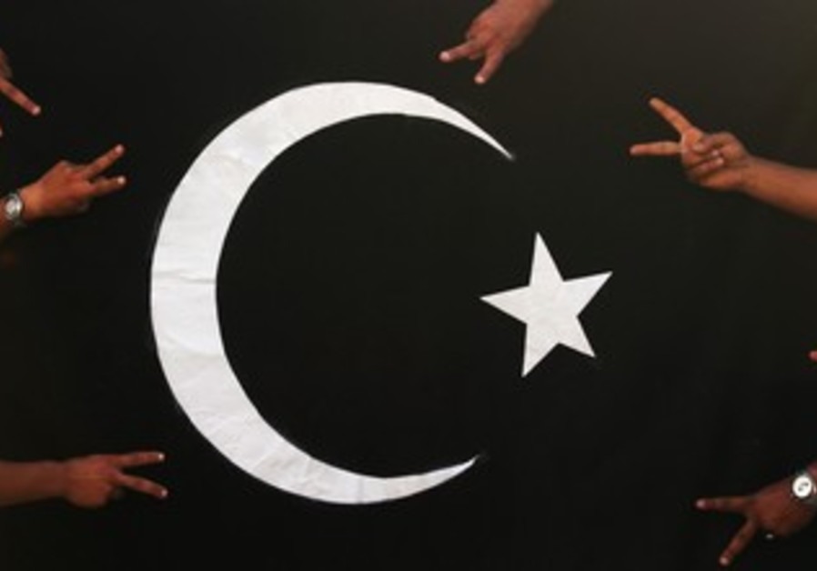 Protesters gesture in front of black flag of Cyren