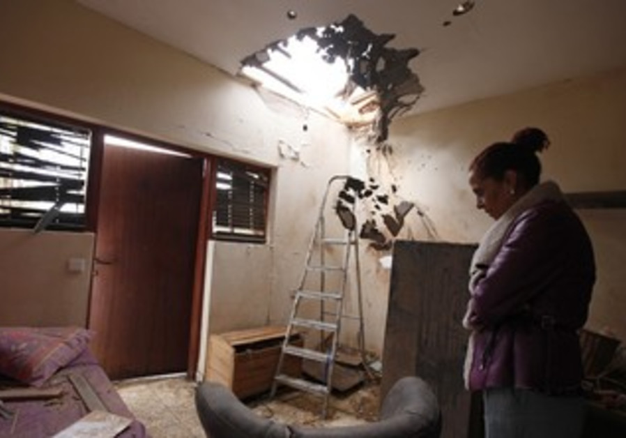 Tami Shadadi surveys damage to her Sderot house
