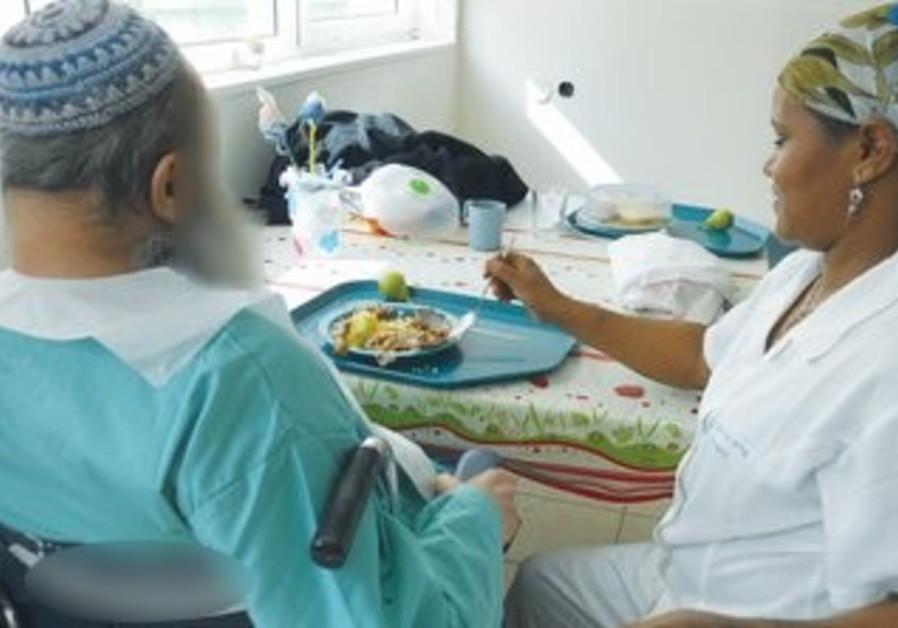 Feeding geriatric patients at Herzog Hospital.