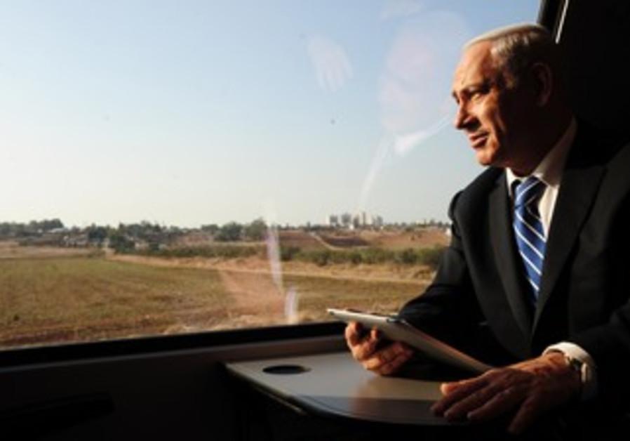 PM Binyamin Netanyahu on train to Beersheba