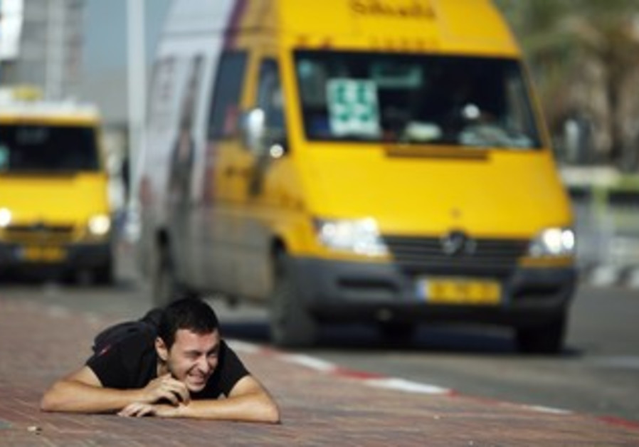 Ashkelon man takes cover during code red siren