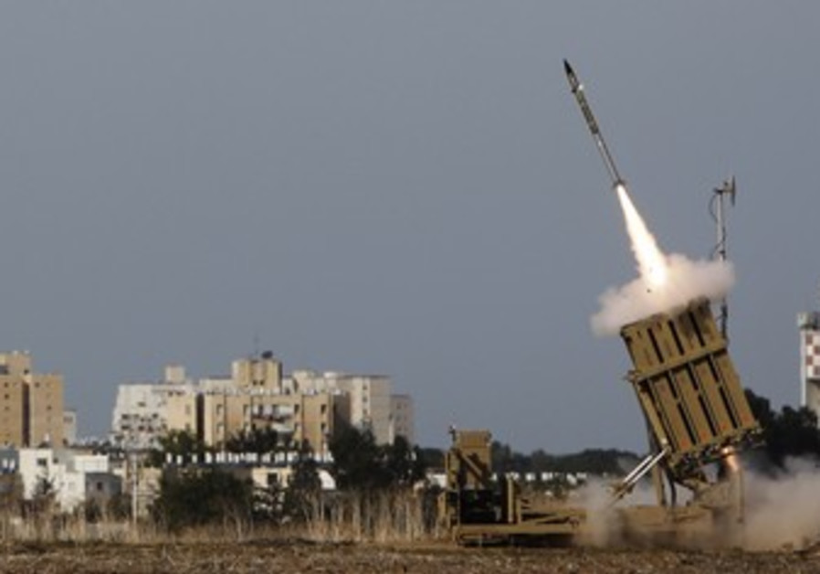 Iron Dome launcher fires an interceptor rocket.