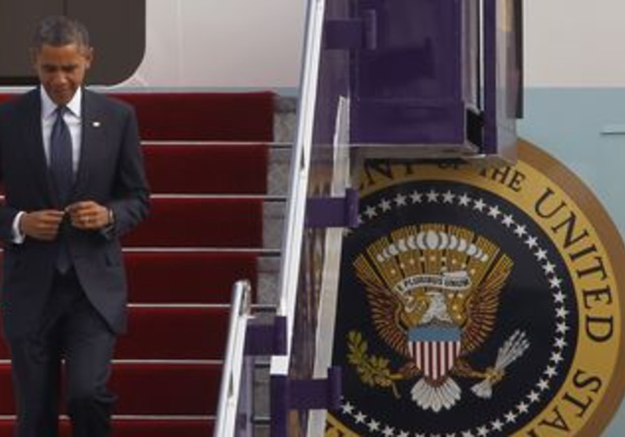 US President Barack Obama deplanes Air Force One