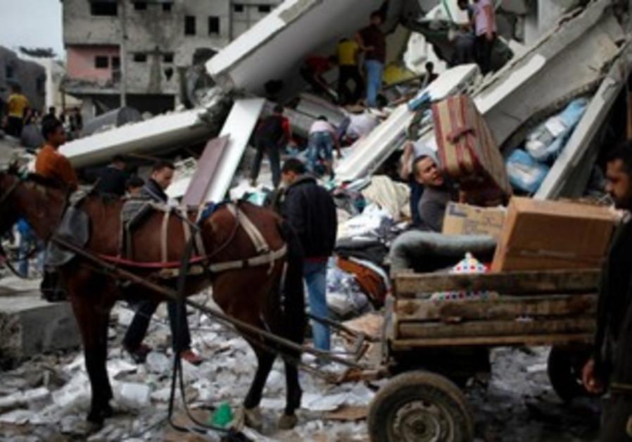 Horse drawn buggy in Gaza amid wreckage and destru