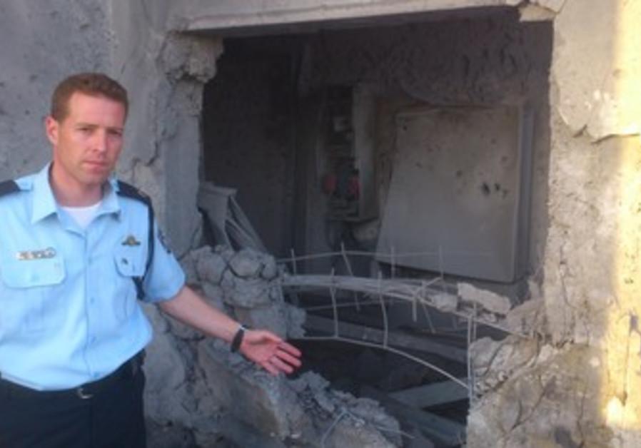 Micky Rosenfeld at site of Ashdod rocket.