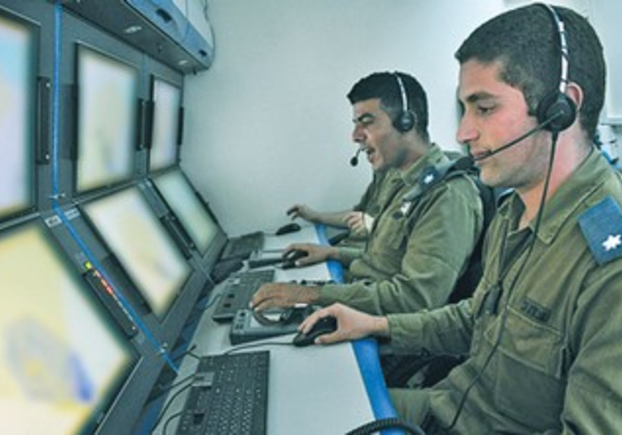 MAJ. ITAMAR ABU (right) commands TA Iron Dome