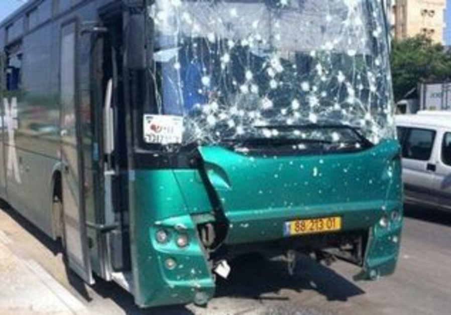 Bus damaged by rocket in Beersheba