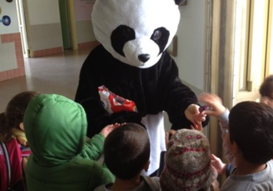 Children at Nitzan scool greeted by a Panda bear