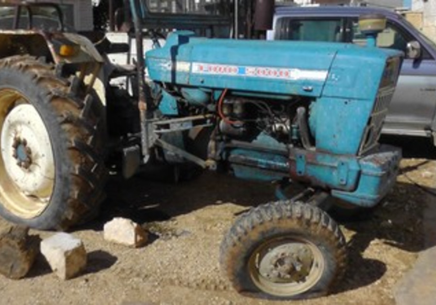 Tractor with tires slashed