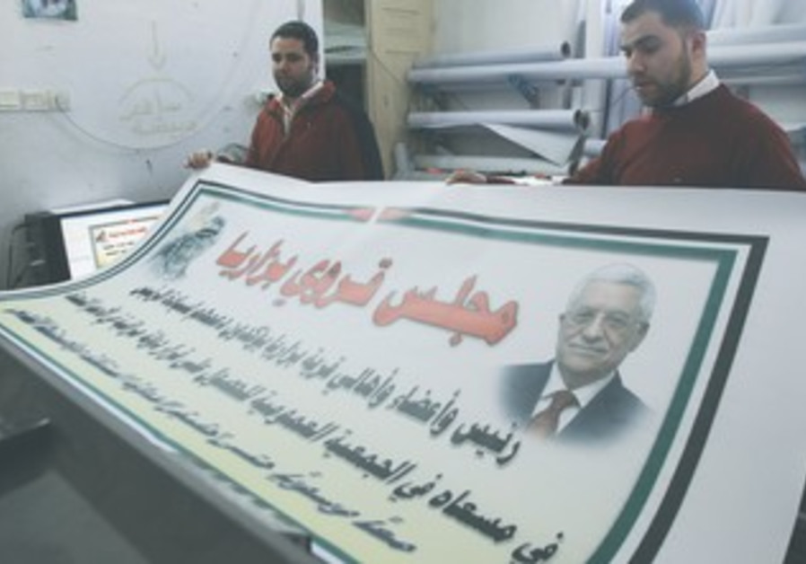Nablus men hold poster of Abbas and Arafat