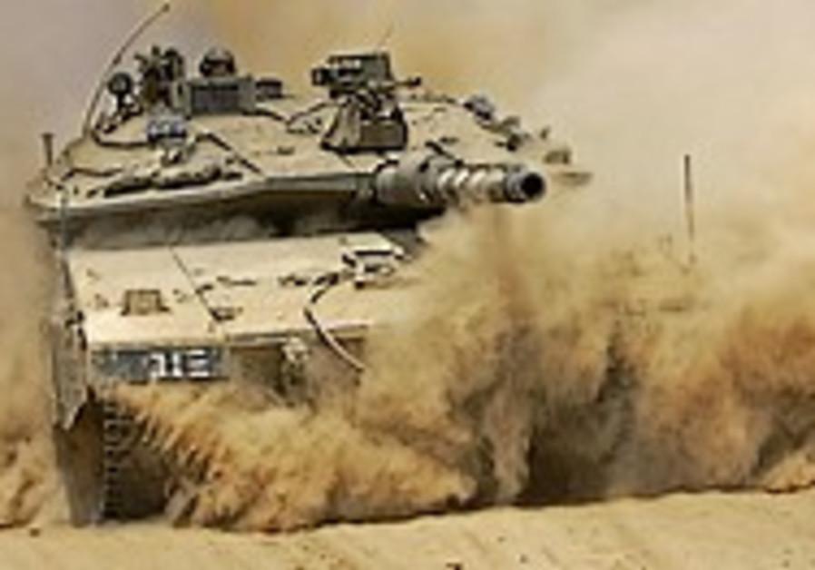 IDF clears troops in journalist's death