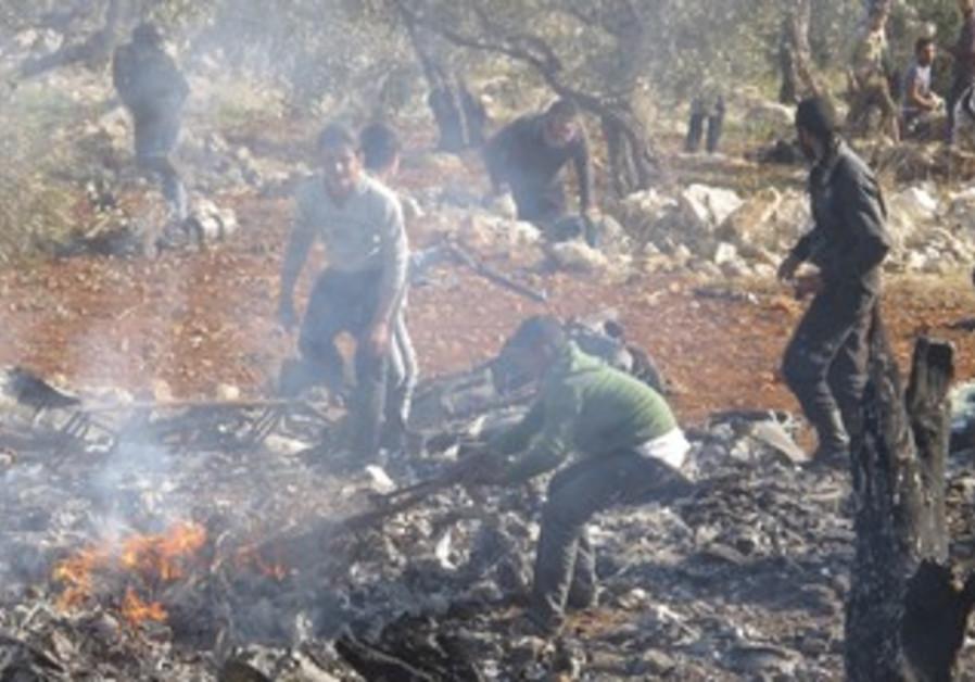 Burning wreckage of  Syrian warplane [file]