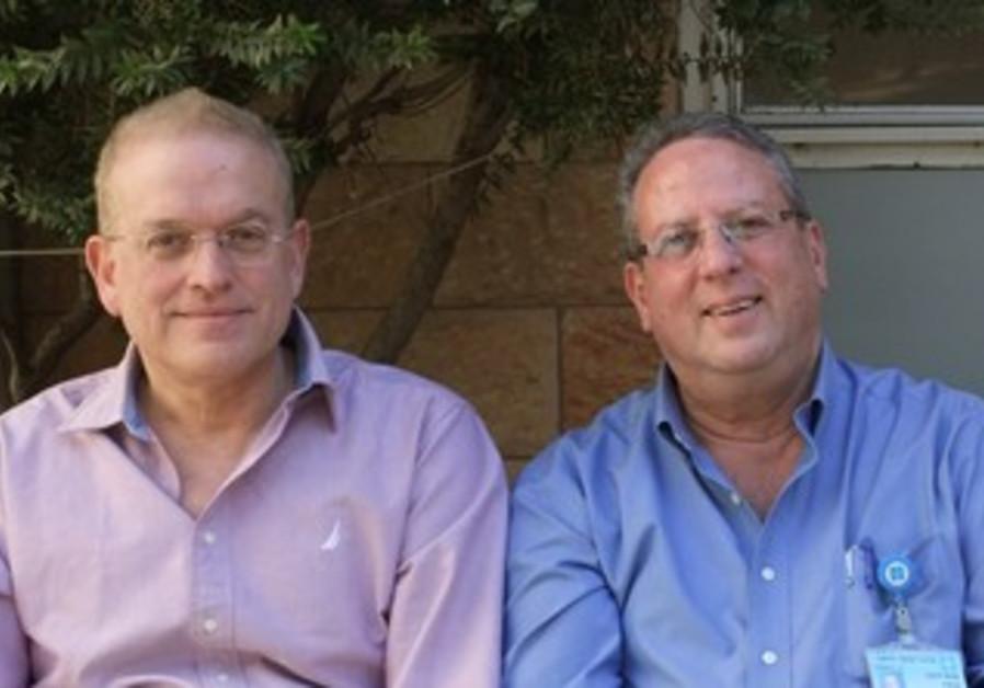 Prof. Eran Leitersdorf and Prof. Benny Drenger.