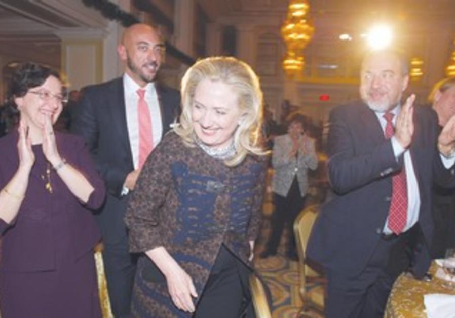 Clinton (middle), Liberman (right)