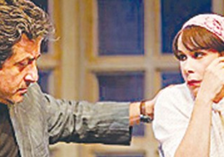 Actress smokes in play 'Hamakom Mimenu Bati'