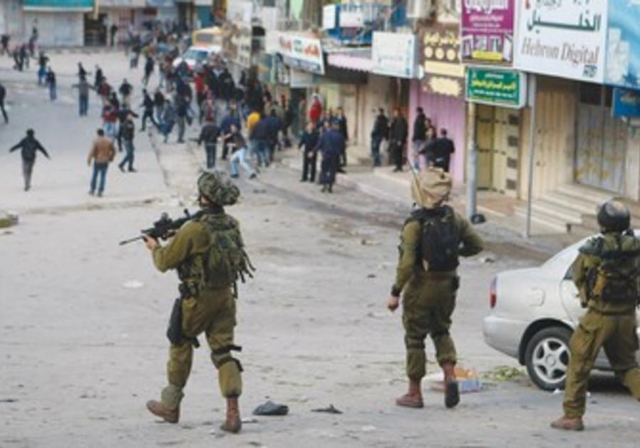 IDF troops disperse Palestinians in Hebron [file]