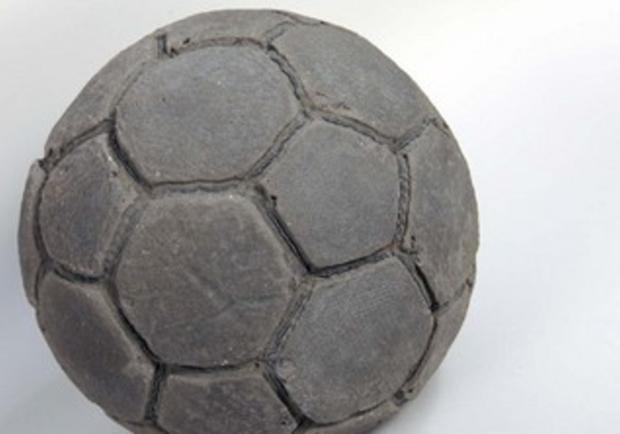Khaled Jarrar with his concrete soccer ball