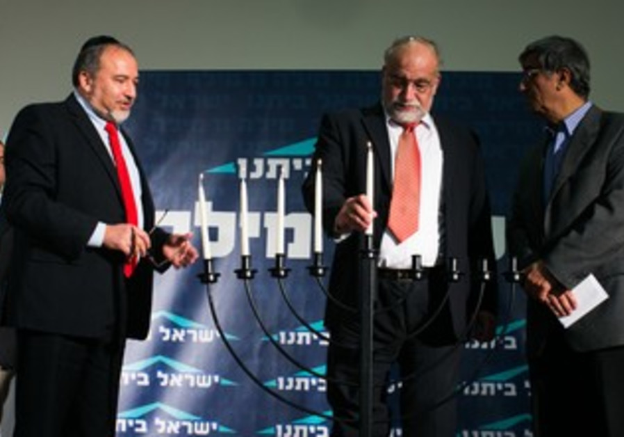 Liberman lights candles with Rotem and Ohayon