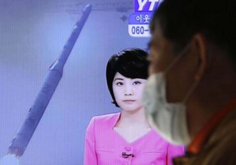 TV report on North Korean rocket launch