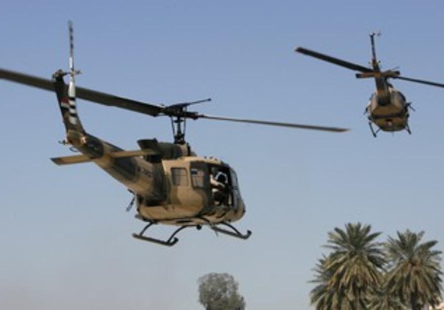 Iraqi Air Force Huey II helicopters [illustrative]