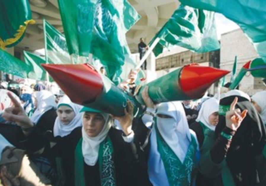 PALESTINIAN WOMEN pose at Hamas rally