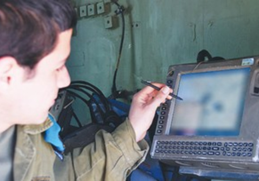 AN IDF soldier uses the 'Digital Ground Army' syst