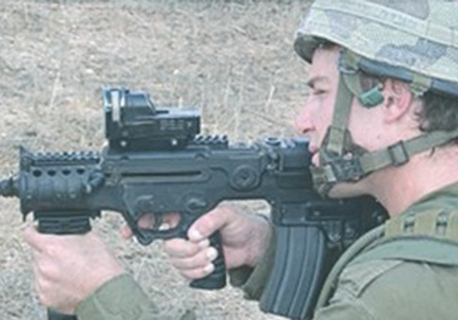 IDF soldier shooting Tavor rifle