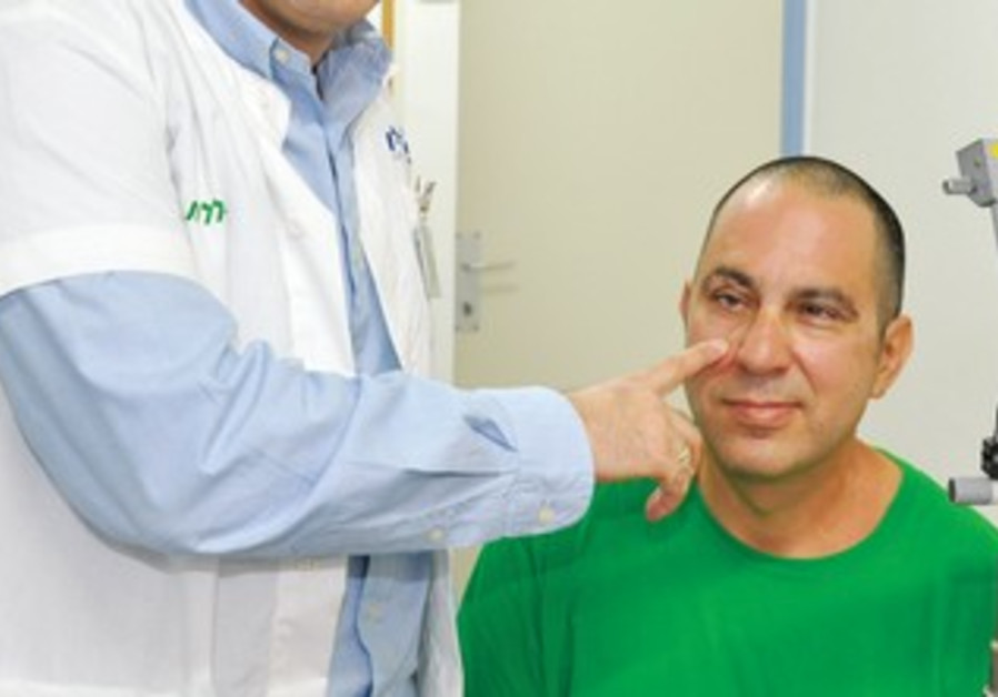 NISSIM NAHUM who suffered war injury in eye.