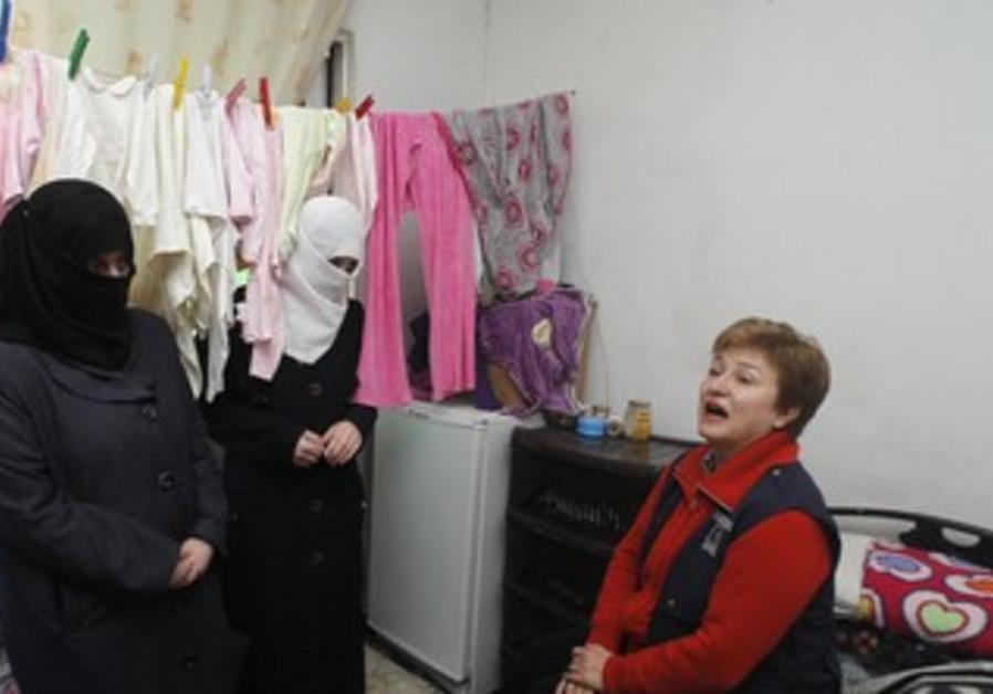EU Commissioner  visits Syria refugees in Amman