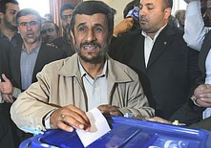 Iranian conservatives consolidate control of parliament in run-off elections
