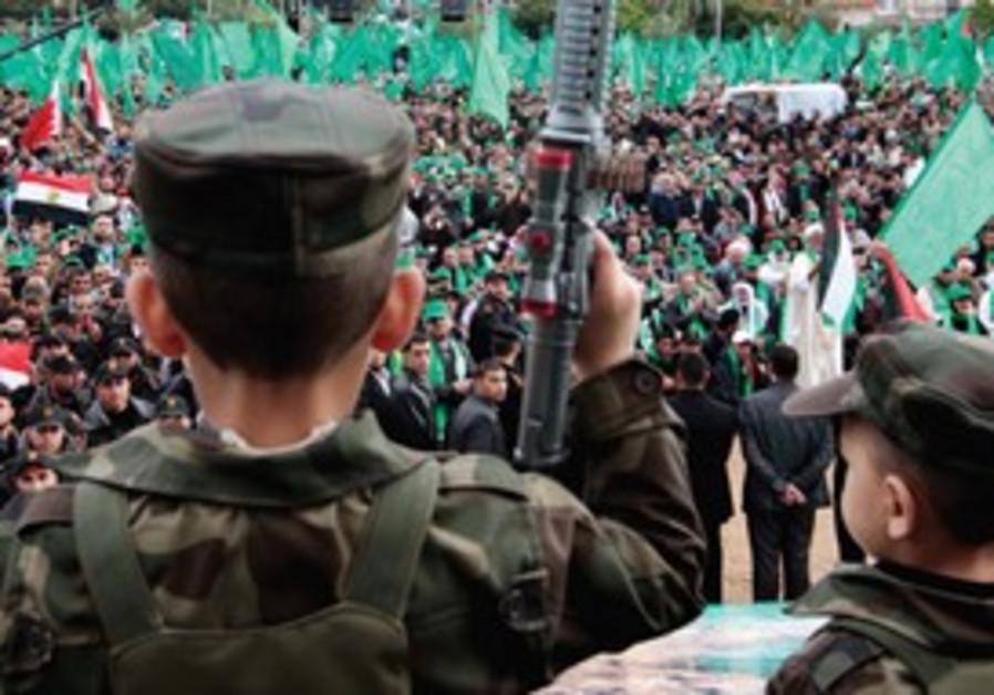 Child waves gun at Hamas rally