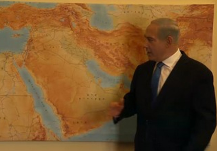 PM points to map in Likud Beytenu campaign video