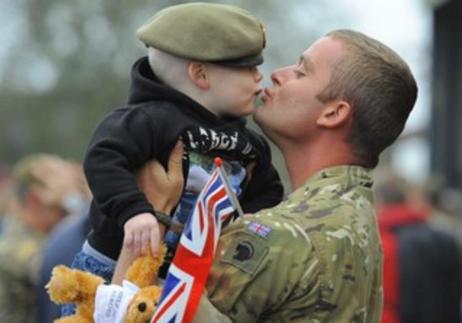 British soldier with son [illustrative].