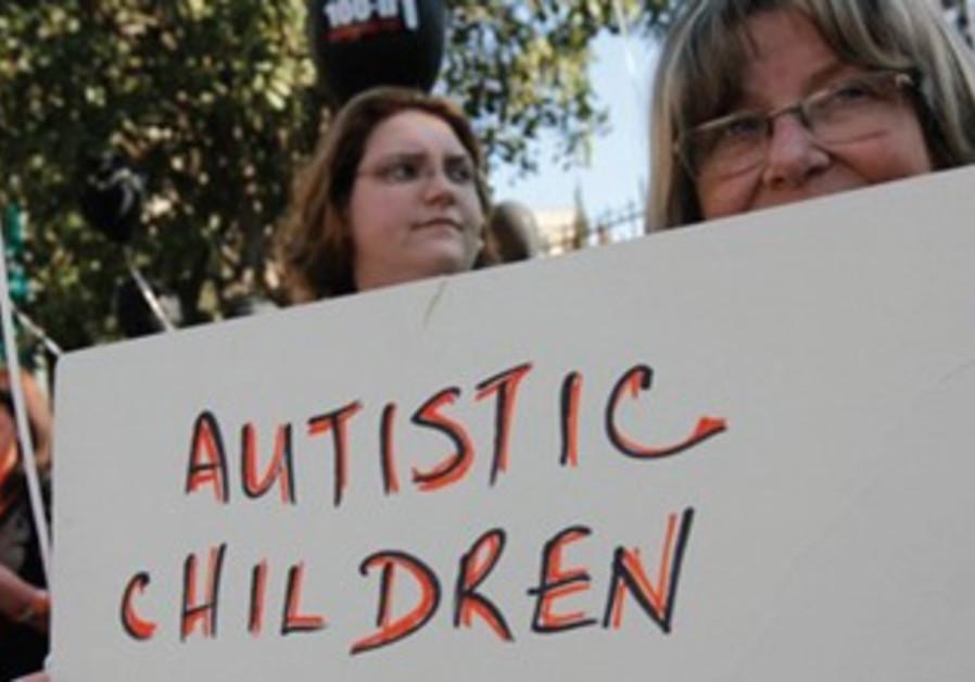 Parents demonstrate for autistic children