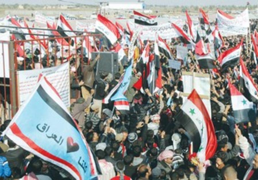 IRAQI SUNNIS wave national flags, Dec. 31, 2012