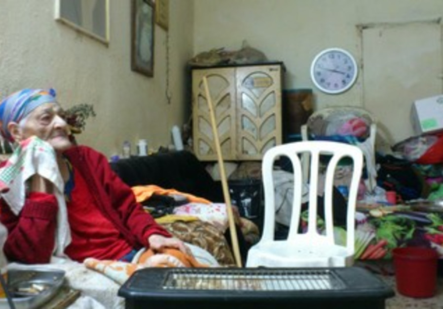 Eldery woman in her house in Argazim neighborhood