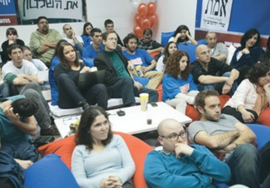 Labor party supporters watch election ads