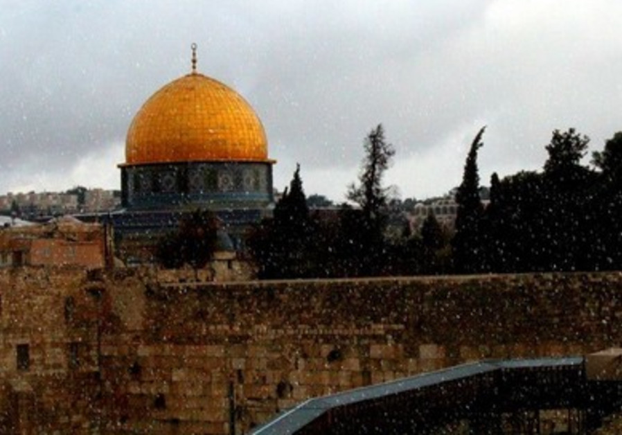 Snow falls in Jerusalem at Western Wall