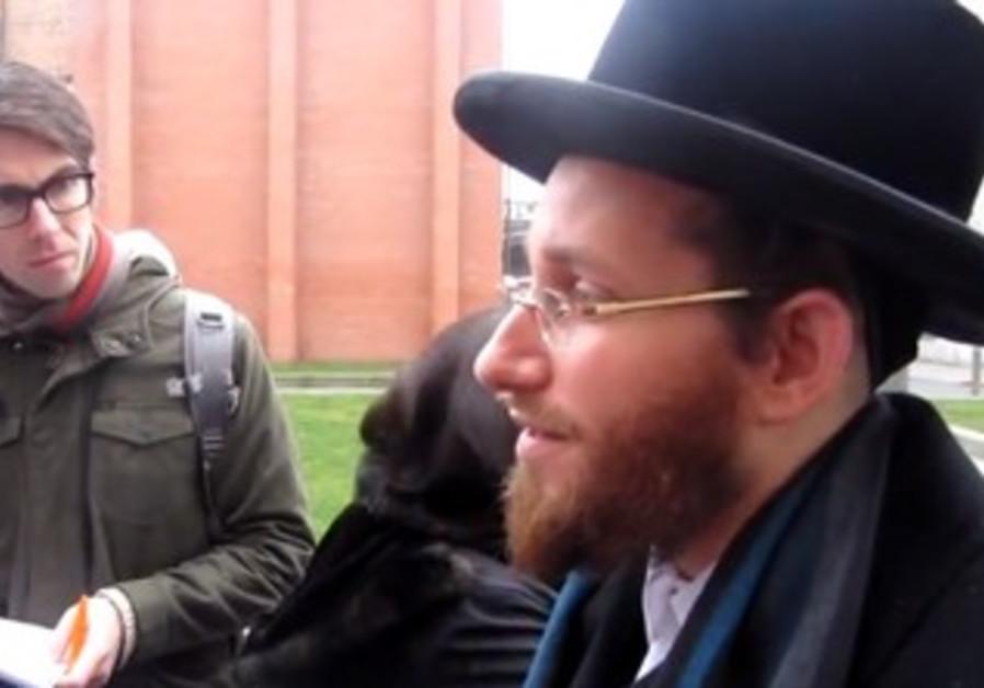 Moshe Aryeh Friedman speaks to reporters