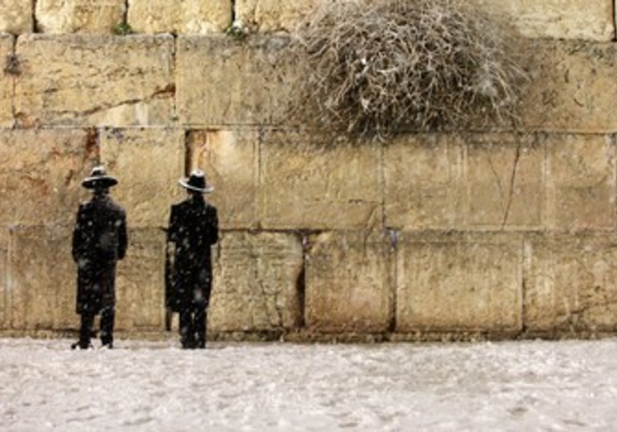 Western Wall in the snow in Jerusalem.
