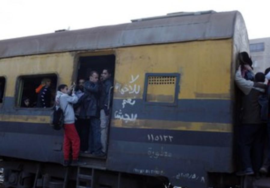 Train rides through shanty town in Cairo. Jan 10