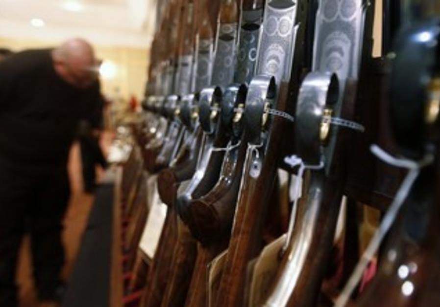 Man looks at shotguns in Connecticut