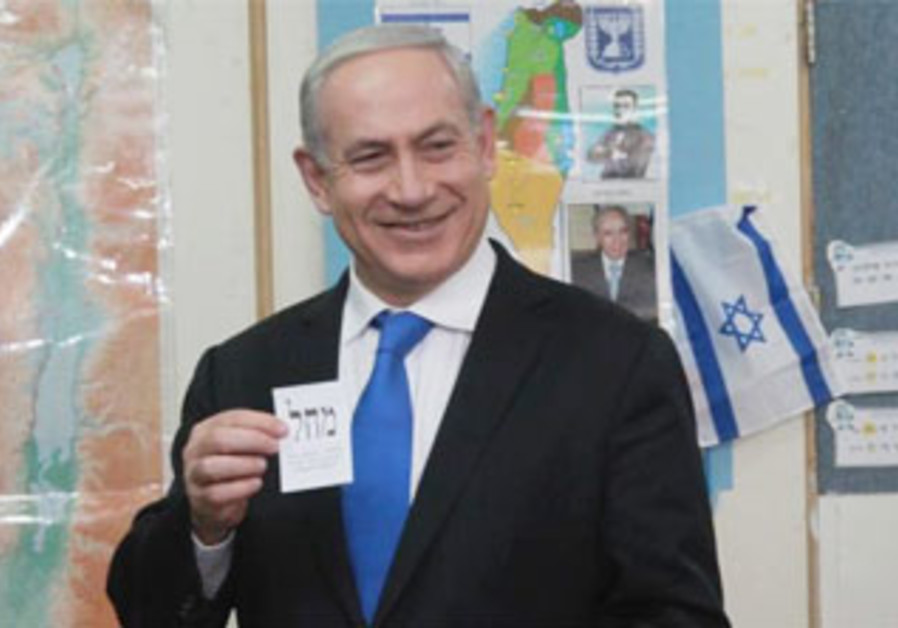 Binyamin Netanyahu smiles as he votes in Jerusalem, January 22, 2013.