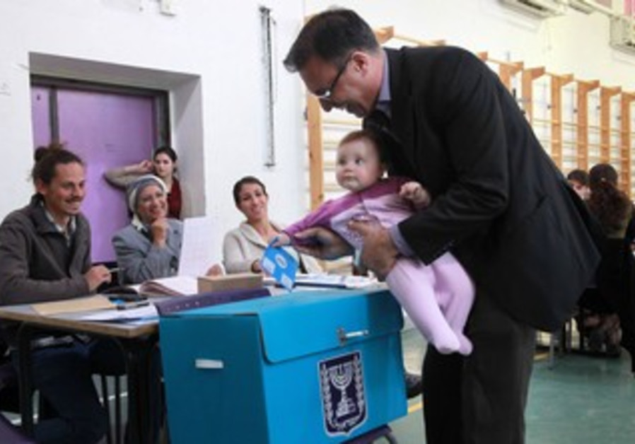 A father and a daughter vote, January 22, 2013.
