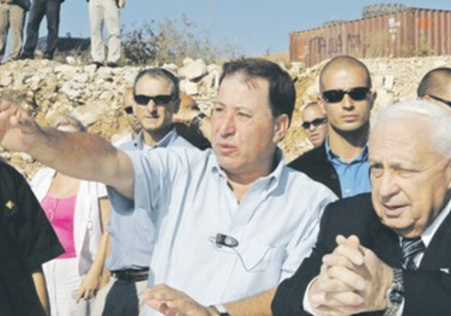 RON Nachman provides a tour of Ariel to then-prime minister Ariel Sharon in 2005