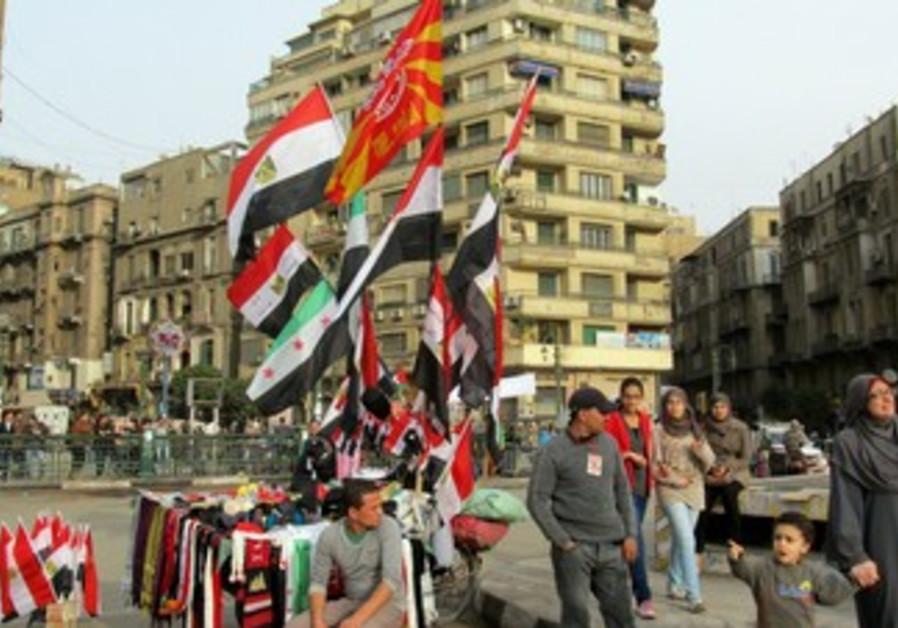 A vendor sells flags in Tahrir Square, January 25, 2013  of President Mohamed Morsi in Cairo