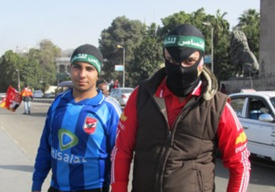 """An """"ultra"""" or soccer hooligan with the El Ahly team, on his way to Tahrir Square on January 26, 2013"""