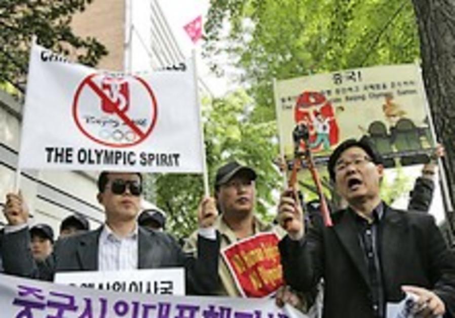 OU, Agudath Israel reject Beijing boycott